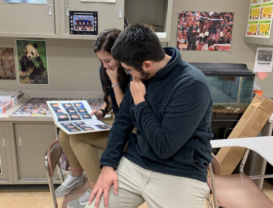 Senior Brena Brown and Drexel King reflect on their time at Immanuel 通过 looking through old yearbooks.